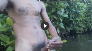 Public masturbation video of horny guy in river